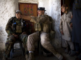 US Marine LCpl Mathew Gorzkiewicz Tries Out an Afghan Boy's Sling During a Patrol in Afghanistan Photographic Print