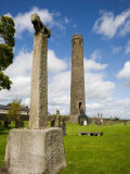 Round Tower and High Cross, St Brigid's Ci Cathedral, Kildare Town, Co Kildare, Ireland Photographic Print