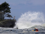 Photographing Heavy Surf Generated by Hurricane Bill While Kayakers and Surfers Wait for a Wave to  Photographic Print