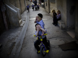 Ultra-Orthodox Jewish Children Cover their Faces as They Play in a Street in Jerusalem Photographic Print