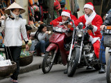 Vietnamese Men Dressed as Santa Claus Wait on their Motorbikes on a Street in Hanoi, Vietnam Photographic Print