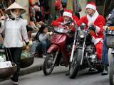 Vietnamese Men Dressed as Santa Claus Wait on their Motorbikes on a Street in Hanoi, Vietnam Photographic Print