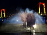 Water Illumination Show With the Backdrop of Illuminated Rainbow Bridge and Tokyo Skyline Photographic Print