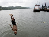 Jumping into Water Near the Ferry to the Nusakambangan Prison Island at Cilacap Port in Indonesia Photographic Print