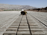 Boy Works at a Brick Factory in Jalalabad, Afghanistan Photographic Print