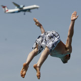Man Jumps Close to a Landing Airplane in a Public Bath in Duesseldorf, Western Germany Photographic Print