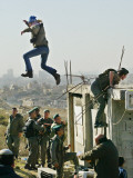 Peace Activist Leaps over Israeli Border Police Trying to Prevent Demolition of House, Jerusalem Photographic Print
