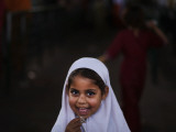 Pakistani Girl Waits for Her Mother to Get Rice During a Donated Food Distribution at the Beri Iman Photographic Print