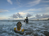 Child as She Plays in the Waves at a Beach in Port Blair, India Photographic Print