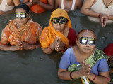 Hindu Devotees Observe a Solar Eclipse as They Take Holy Dips in the Sangam in Allahabad, India Photographic Print