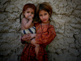 Afghan Girl Holds Her Younger Sister in Nangarhar Province, East of Kabul, Afghanistan Photographic Print