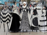 "Models on Stilts Present ""High Fashion"" on the Famous ""Jungfernstieg"" Boulevard in Hamburg, Germany Photographic Print"