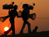 Indian Vendors Return Home after Selling Snacks at Sangam in Allahabad, India Photographic Print
