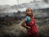 Crying, Standing at the Site Where Her House Used to Be, after a Fire at a Slum Area of New Delhi Photographic Print