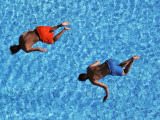 Two Young Men Jump from a Tower in an Outdoor Swimming Arena in Stuttgart, Southern Germany Photographic Print