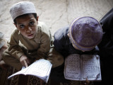 Afghan Refugee Children Read Verses of the Quran During a Daily Class at a Mosque in Pakistan Photographic Print