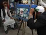 Afghan Street Photographer Takes a Portrait of a Customer with a Wooden Made Camera Photographic Print