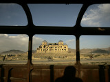 Afghan Drives Past the Darul Aman's Palace in the City of Kabul, Afghanistan Photographic Print