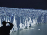 Tourist Looks Out at the Perito Moreno Glacier as it Descends into Argentino Lake Photographic Print
