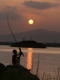 Pakistan Boy Fishing at Rawal Lake in the Suburb of Pakistani Capital Islamabad Photographic Print