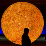 Visitor Passes a Replication of the Sun at the Gasometer in Oberhausen, Western Germany Photographic Print
