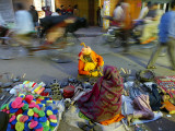 Indian Holy Man Shops for Tools on the Street in Front of an Old Delhi Market Photographic Print