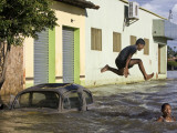 Children Play in a Flooded Street in Trizidela Do Vale, Maranhao State, Brazil Photographic Print
