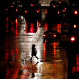Pedestrian in Rain-Soaked Street in Country Club Plaza Shopping District of Kansas City, Missouri Photographic Print