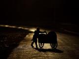 Pakistani Boy Pushes a Cart Along the Main Street in Rawalpindi, Pakistan Photographic Print