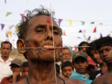 Gathering around Hindu Devotee Who Has His Tongue Pierced with Iron Pins, Bengali New Year in India Photographic Print