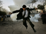 Pakistani Lawyer Runs Away from Tear Gas Fired by Police Officers During a Protest in Islamabad Photographic Print