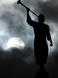 Statue is Seen Against a Cloudy Sky and a Partial Solar Eclipse in Bogota, Colombia Photographic Print