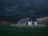 Old Barn Stands in a Wheat Field as a Thunderstorm Passes in the Distance Near Ogallah, Kansas Photographic Print