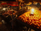 Afghan Fruit Vendor Waits for Customer at a Local Market in Kabul, Afghanistan Photographic Print