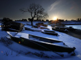 Sun Rises in Mackerel Cove on Bailey Island Where Fishermen's Skiffs Wait Out the Winter, in Maine Photographic Print