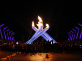 Surrounding the Olympic Flame after the Opening Ceremony of the Vancouver 2010 Olympics Photographic Print
