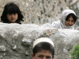 Afghan Children Look on as US Soldiers Patrol in Khost, Afghanistan Photographic Print