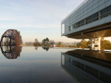 Image of the Clinton Library Building and an Old Bridge Reflected in a Pool Photographic Print
