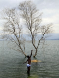 Youth Fishes in Lake Azuei Near the Border with the Dominican Republic in Malpasse, Haiti Photographic Print