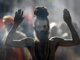 Naked Hindu Holy Man Performs Rituals on Banks of River Ganges During the Kumbh Mela in India Photographic Print