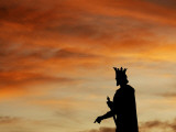 Statue of Prince Mircea is Silhouetted as the Sun Sets in Pitesti, Romania Photographic Print