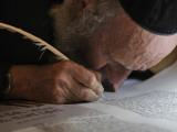 Ultra-Orthodox Jew Writes Some of the Last Words in a Torah Scroll Photographic Print