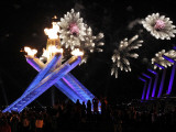 Surrounding the Olympic Flame as Fireworks Explode after the Opening Ceremony of 2010 Winter Games Photographic Print
