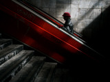 Woman Uses an Escalator at a Pedestrian Underpass in Belgrade, Serbia Photographic Print