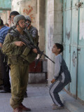 Israeli Soldier Tells a Palestinian Boy to Leave the Scene Following a Knife Attack Photographic Print