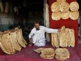Baker Arranges Breads at His Shop in Kandahar Province, South of Kabul, Afghanistan Fotografisk trykk