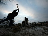 Man Chops Firewood at an Open Air Wood Market Near the Bulgarian Capital Sofia Photographic Print