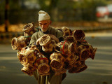 Kashmiri Carries 'Kangris' or Firepots to Sell in a Market in Srinagar, India Photographic Print