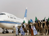 Libyan Camel Riders Holding Flags of Arab Countries Welcome Kuwaiti Airplane Carrying the Emir Photographic Print