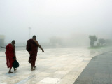 Buddhist Monks Walk Along a Road to Kyeik-Hti-Yoe Pagoda in Kyeikhto Photographic Print